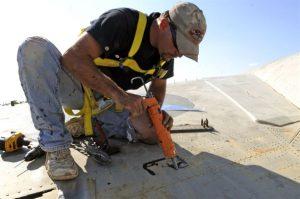 Roofing contractor replacing a roof in Scranton